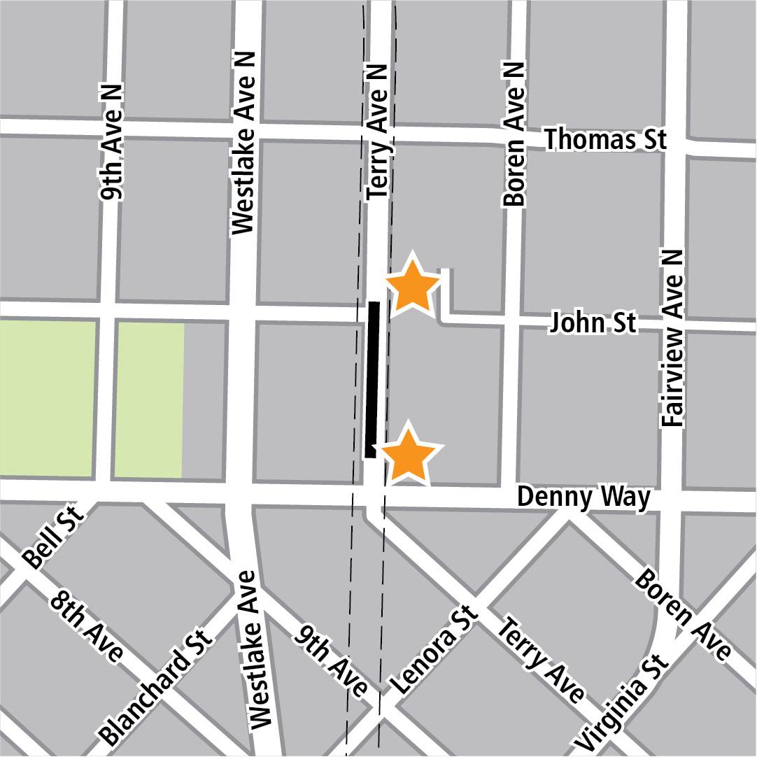 Vẽ bản đồ có hình chữ nhật màu đen biểu thị vị trí trạm ga ở Terry Avenue North và các ngôi sao màu vàng biểu thị hai khu vực vào trạm ga.