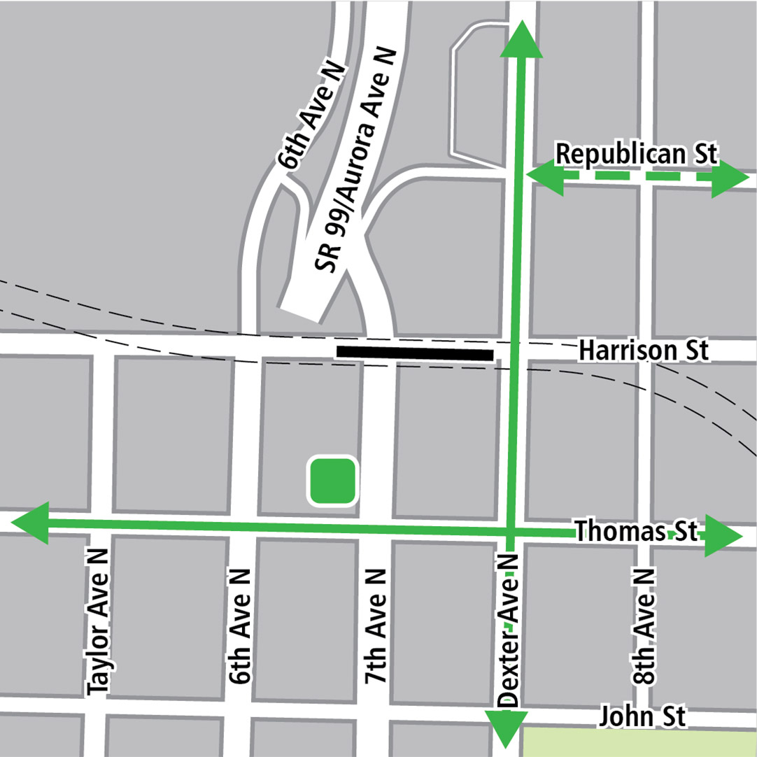 Map with black rectangle indicating station location on Harrison Street, green lines indicating existing bike routes, dashed green lines for planned bike routes and a green square indicating a bike storage area.